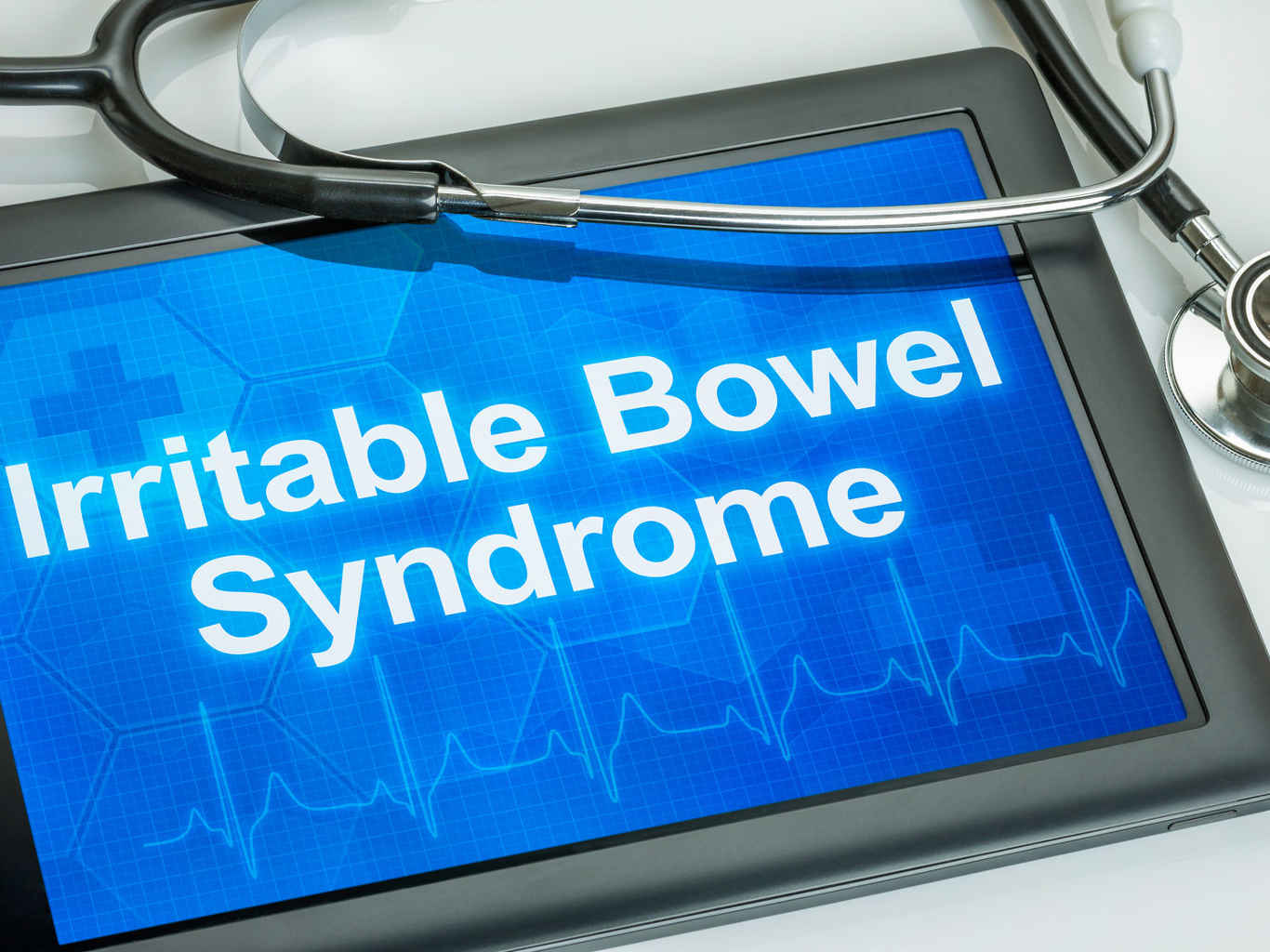 Tablet displaying 'Irritable Bowel Syndrome'.